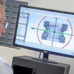 Lab technician using digital technology to produce an appliance